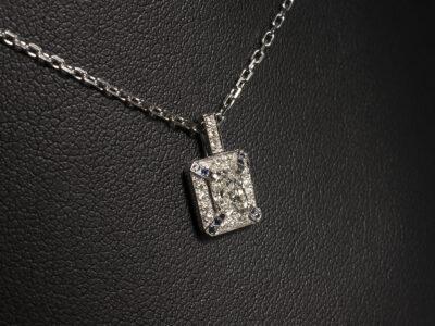 9kt White Gold Pavé and Claw Set Diamond and Sapphire Pendant, Radiant Cut Diamond 0.45ct G Colour VS2 Clarity, Round Brilliant Cut Diamond Halo and Bale, Round Brilliant Cut Sapphires
