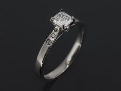 Ladies Diamond Engagement Ring, Platinum Design with Claw Set Asscher Cut Diamond 0.39ct F-G Colour VS Min, Rub over and Secret Set Round Brilliant Cut Diamond Shoulders 0.06ct (8)
