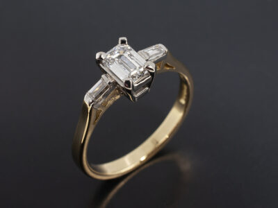 Ladies Diamond Trilogy Engagement Ring, 18kt White Claw Set and Yellow Gold Design, Emerald Cut Diamond 0.50ct D Colour VS2 Clarity and Baguette Cut Diamond Side Stones 0.14ct Total