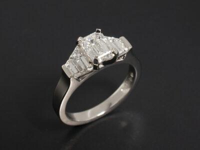 Ladies Diamond Trilogy Engagement Ring, Platinum Claw & Bar Set Design, Emerald Cut Lab Grown Diamond 1.00ct E Colour VS2 Clarity, Trapezium Cut Diamond Side Stones 1.04ct Total F Colour VS Clarity Min