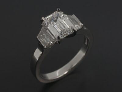 Ladies Diamond Trilogy Engagement Ring, Platinum Claw Set Design, Emerald Cut Diamond 1.23ct D Colour VS2 Clarity, Trapezium Cut Diamond Side Stones 0.40ct (2) F Colour VS2 Clarity Min