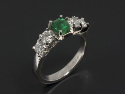Ladies Diamond and Emerald Dress Ring, Platinum Claw Set Design, Customers own Stones - Emerald Cut Emerald 0.68ct, Round Brilliant Cut Diamonds 0.63ct (2), 0.30ct (2)