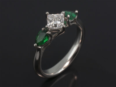 Ladies Diamond and Emerald Trilogy Dress Ring, Platinum Claw Set Design, Princess Cut Diamond 0.62ct E Colour VS1 Clarity, Pear Shape Emeralds, 0.44ct (2)