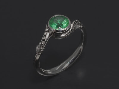 Ladies Emerald Dress Ring, Platinum Rub over Set Design, Round Brilliant Cut Emerald 0.61ct, Fern Detail Band