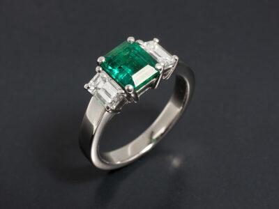 Ladies Emerald and Diamond Ring, 18kt White Gold Claw Set Trilogy Design, Emerald Cut Emerald 1.13ct, Emerald Cut Diamonds 0.83ct Total F Colour VS Clarity Min
