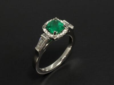 Ladies Emerald and Diamond Dress Ring, Platinum Cut Claw Set Halo Design, Cushion Cut Emerald 0.69ct, Tapered Baguettes 0.34ct, Round Brilliant Cut Diamonds 0.08ct Total
