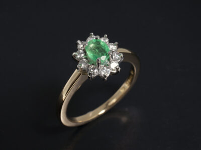 Ladies Emerald and Diamond Dress Ring, Platinum and 18kt Yellow Gold Cluster Design, Oval Cut Emerald 0.35ct, Round Brilliant Cut Diamonds 0.31ct Total