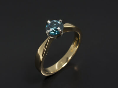 Ladies Coloured Diamond Solitaire Engagement Ring, Platinum and 18kt Yellow Gold 4 Claw Set Design, Round Brilliant Cut Blue Treated Diamond 0.77ct, NSEW Design