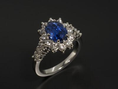 Ladies Sapphire and Diamond Dress Ring, Platinum Claw Set Halo Design, Oval Cut Sapphire 1.82ct, Round Brilliant Cut Diamonds 0.73ct Total