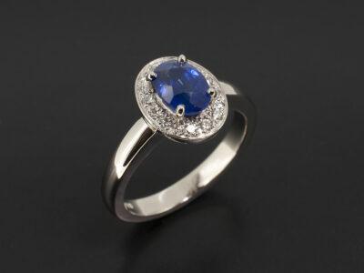 Ladies Sapphire and Diamond Dress Ring, Platinum Claw and Pavé Set Halo Design , Oval Cut Sapphire 1.04ct, Round Brilliant Cut Diamonds