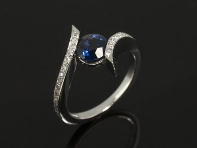 Ladies Sapphire and Diamond Dress Ring, Platinum Tension and Pavé Set Design, Round Brilliant Cut Sapphire 1.13ct, Round Brilliant Cut Diamond Shoulders 0.14ct Total, Twist Detail