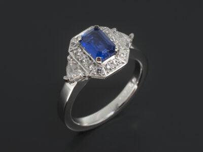 Ladies Sapphire and Diamond Halo Dress Ring, Platinum Claw and Pave Set Design, Emerald Cut Sapphire 0.95ct, Cadillac Cut Diamond Side Stones 0.41ct (2), Round Brilliant Cut Pave Halo