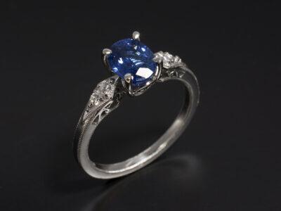 Ladies Sapphire and Diamond Ring, Platinum Claw and Pavé Set Design, Oval Cut Sapphire 1.26ct, Round Brilliant Cut Diamonds 0.06ct with Antique Millgrain Detail