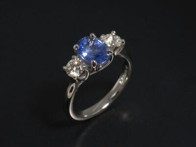 Ladies Sapphire and Diamond Trilogy Dress Ring, Platinum Claw Set Crossover Design, Oval Cut Sapphire 1.35ct, Round Brilliant Cut Diamonds 0.51ct Total