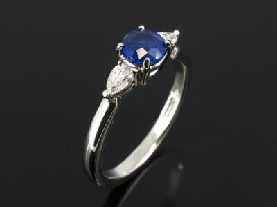 Ladies Sapphire and Diamond Trilogy Dress Ring, Platinum Claw Set Design, Round Blue Sapphire 0.66ct (2), Pear Shape Diamonds 0.20ct F Colour SI Clarity Min