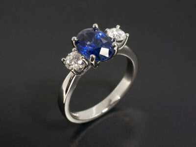 Ladies Sapphire and Diamond Trilogy Ring, Platinum Tulip Shaped Claw Set Design, Oval Sapphire 2.12ct, Round Brilliant Cut Diamonds 0.40ct Total