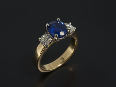 Ladies Sapphire and Diamond Trilogy Ring, Platinum and 18kt Yellow Gold Claw Set, Oval Sapphire 1.72ct, Round Brilliant Cut Diamonds 0.26ct and 0.29ct