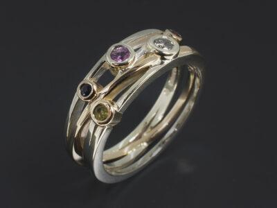 Ladies Semi Precious Stone Dress Ring, 9kt Yellow and White Gold Rub over Set Satellite Design, Garnet, Pink Sapphire, Blue Sapphire, Peridot and Salt & Pepper Diamond