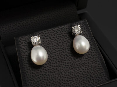 Platinum Claw Set Drop Design Diamond and Pearl Earrings, Round Brilliant Cut Lab Grown Diamonds 0.60ct Total and Teardrop Fresh Water Pearls