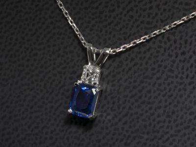 Platinum Claw Set Sapphire and Diamond Pendant, Emerald Cut Sapphire 1.39ct., Asscher Cut Diamond 0.30ct. F Colour, VS Clarity Minimum with Split Bale Design