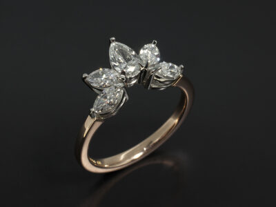 Platinum and 18kt Rose Gold Claw Set Fitted Wedding Ring with Marquise Cut Diamonds 0.66ct and Pear Cut Diamond 0.33ct