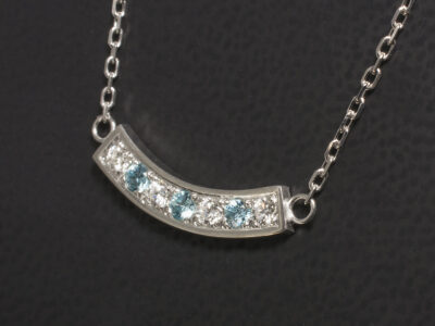 White Gold Pavé Set Blue Zircon and Diamond Pendant, Round Brilliant Cut Diamonds and Blue Zircons in Curved Design on a16-18 Inch Angled Filed Trace Chain